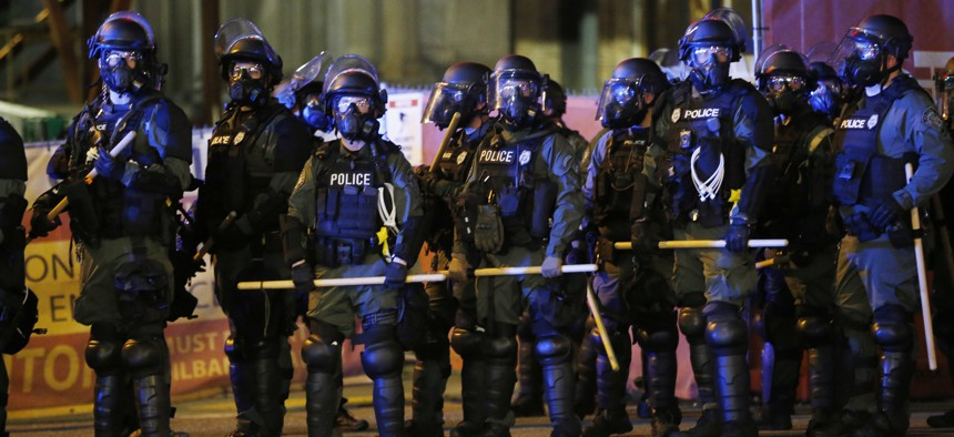 Police in riot gear prepare to disperse a group of protesters as they march through downtown for a third night of unrest on May 31, 2020, in Richmond, Va.