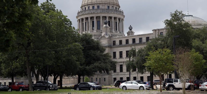 In this July 6, 2020 photo, Mississippi legislators, staff and Capitol employees take advantage of a drive-thru COVID-19 testing center on the Capitol grounds in Jackson, Miss.