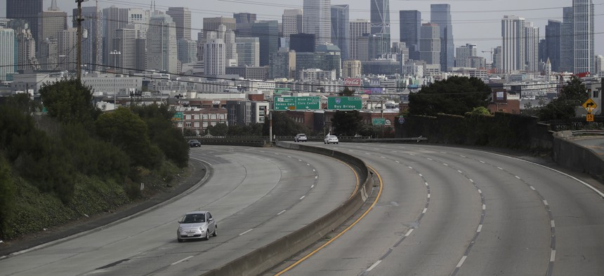 In this March 29, 2020 file photo, light traffic is seen on Highway 101 in San Francisco, amid coronavirus concerns.