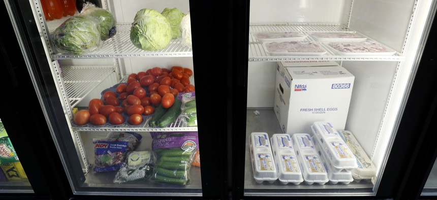 Produce, meat and eggs sit in a cooler at a local super market, Friday, May 29, 2020, in Des Moines, Iowa.