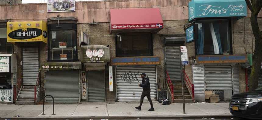 In this April 8, 2020, photo, small businesses are shuttered closed during the coronavirus epidemic in the Crown Heights neighborhood of the Brooklyn borough in New York.