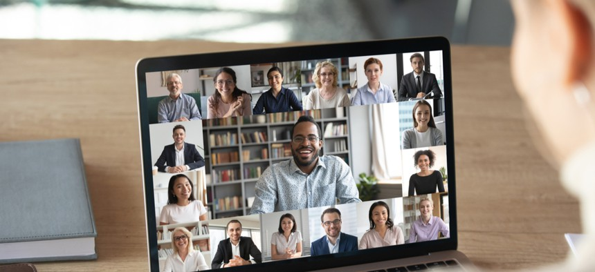 Staff participating in a virtual video call.