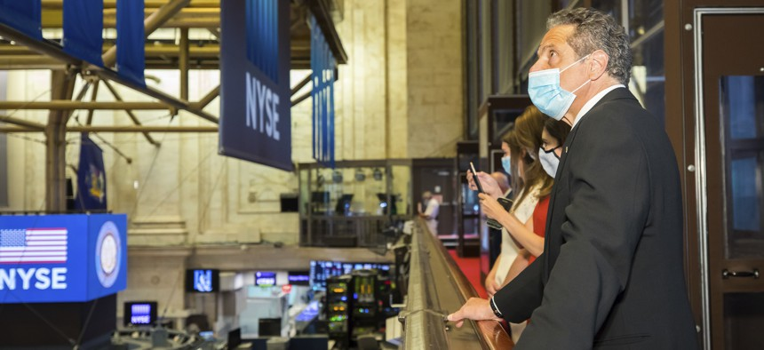 New York State Gov. Andrew Cuomo rings the opening bell with New York Stock Exchange President Stacey Cunningham to mark the historic reopening of the NYSE Trading Floor on May 26, 2020, in New York.