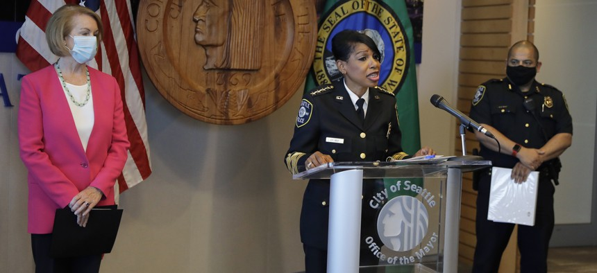 Seattle Police Chief Carmen Best, center, speaks as Seattle Mayor Jenny Durkan, left, and Deputy Police Chief Adrian Diaz, right, look on during a news conference on Aug. 11, 2020, in Seattle.