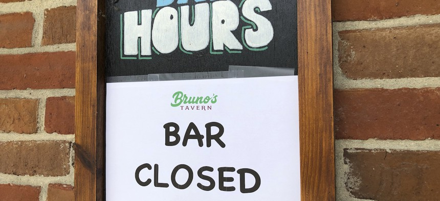 A sign hangs outside Bruno's Tavern in New Orleans on Tuesday, July 14, 2020.