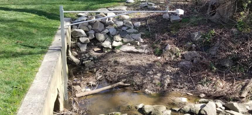 A sensor keeps tabs on water levels in the Walnut Creek stream basin in Cary, N.C.