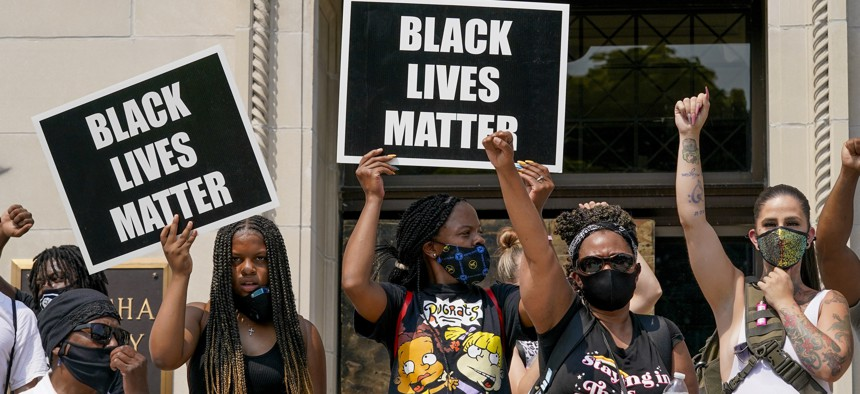 A small group of Black Lives Matter protesters hold a rally on the steps of the Kenosha County courthouse Monday, Aug. 24, 2020, in Kenosha, Wis.