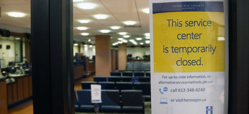 The Hennepin County Government Center service center stands closed Tuesday, March 17, 2020 in Minneapolis where efforts to slow the spread of the coronavirus continue. (AP Photo/Jim Mone)