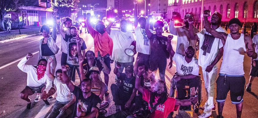 Black Lives Matter protestors demonstrate at the corner of 6th and Broadway in Louisville, Kentucky after the police shooting of Jacob Blake on August 23, 2020 in Kenosha, Wisconsin.