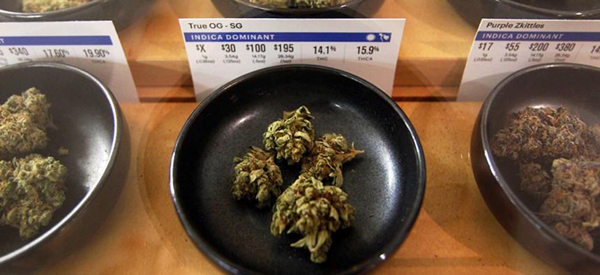 This 2018 photo shows marijuana on display at a marijuana dispensary in Oakland, Calif.