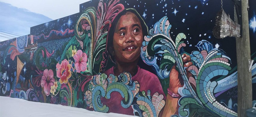 A mural of a Micronesian girl on the side of Bergen's Prairie Market in Milan, Minnesota. The rural town in Southwest Minnesota is seeing an influx of people from Chuuk State in the Federated States of Micronesia.