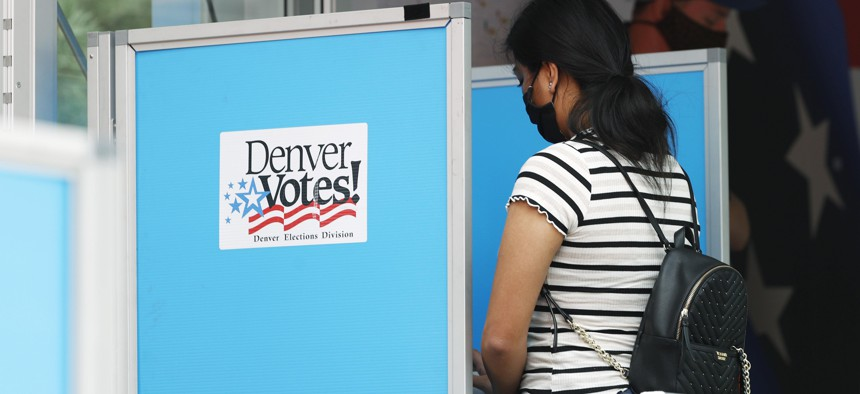 A voter casts a ballot in Denver during Colorado's June 2020 primary election.