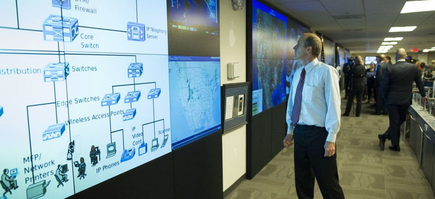 One of the large video screens is checked in the Department of Homeland Security's National Cybersecurity and Communications Integration Center (NCCIC) in Arlington, Va., Wednesday, Aug. 22, 2018.