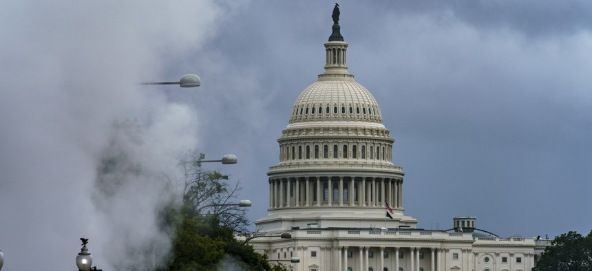 The Capitol is seen in the distance as steam clouds billow up from beneath a construction area on Pennsylvania Avenue in Washington, Thursday, Sept. 10, 2020.