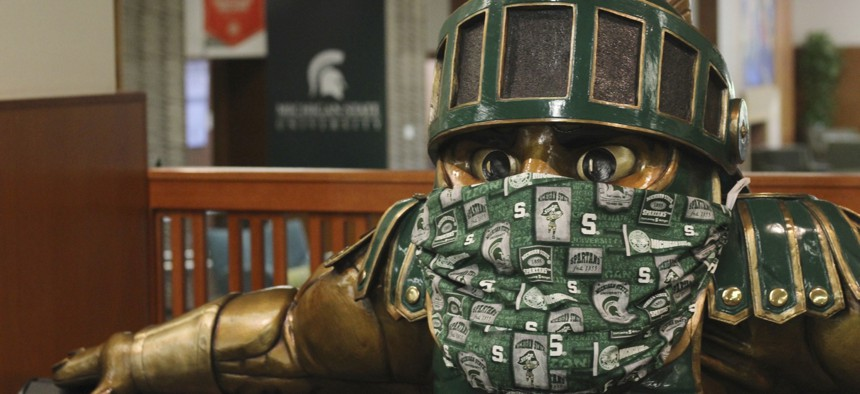 A face mask on the Sparty statue inside the the Michigan State University Student Union is seen on Aug. 21, 2020. Like other schools, Michigan State, which is online only this semester, expect to enroll fewer international students this year.