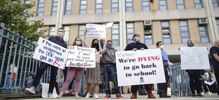 Students and teachers from Benjamin N. Cardozo High School in Oakland Gardens, Queens, New York held a protest against in-person learning as teachers raise new concerns over schools' readiness against Covid-19 on Sept. 17, 2020.