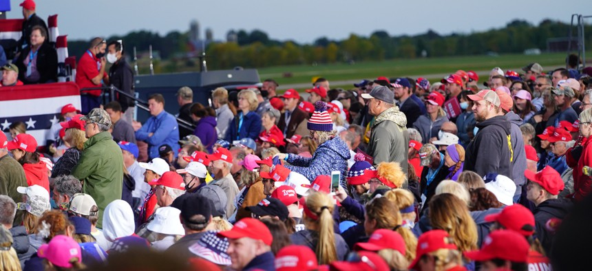 People listen as President Donald Trump speaks at a rally on Sept. 17 in Mosinee, Wisconsin.