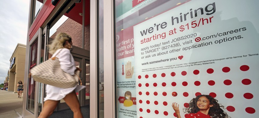 In this Sept. 2, 2020, file photo, a help wanted sign hangs on the door of a Target store in Uniontown, Pa. Despite gains, there were signs job growth was slowing last month.