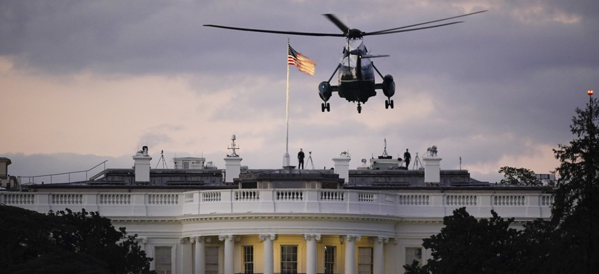 President Donald Trump arrives back at the White House aboard Marine One, Monday evening, Oct. 5, 2020 in Washington, after being treated for COVID-19 at Walter Reed National Military Medical Center.