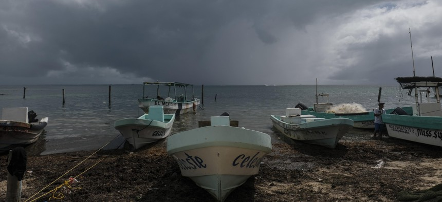 Boats sit closer to the shore after they were secured by fishermen preparing for the arrival of Hurricane Delta in Puerto Juarez, Cancun, Mexico, Tuesday, Oct. 6, 2020. The storm is expected to hit the U.S. Gulf Coast later this week.
