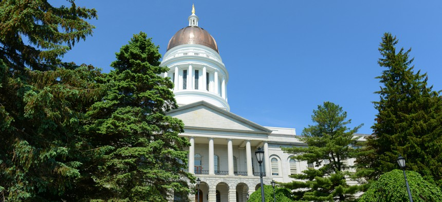 The Maine Statehouse. Maine lawmakers were split whether 2020 was the moment to kill the commission or invest heavily in a public defender office to bolster it.
