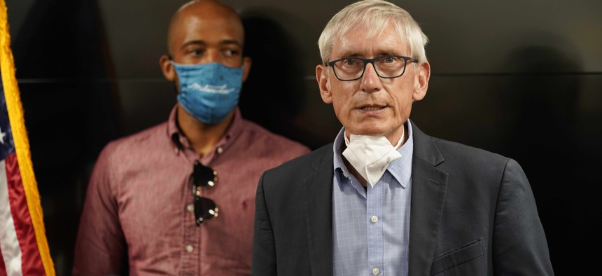 In this Aug. 27, 2020 photo, Wisconsin Gov. Tony Evers speaks during a news conference in Kenosha, Wis. Wisconsin health officials and Gov. Evers announced Wednesday, Oct. 7, 2020, that they're opening a field hospital at the state fairgrounds.