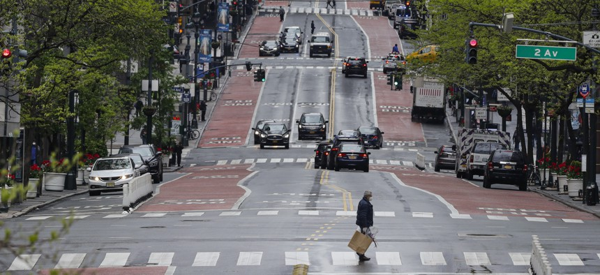 Pedestrians cross a nearly empty 42nd Street Friday, May 8, 2020, in New York.