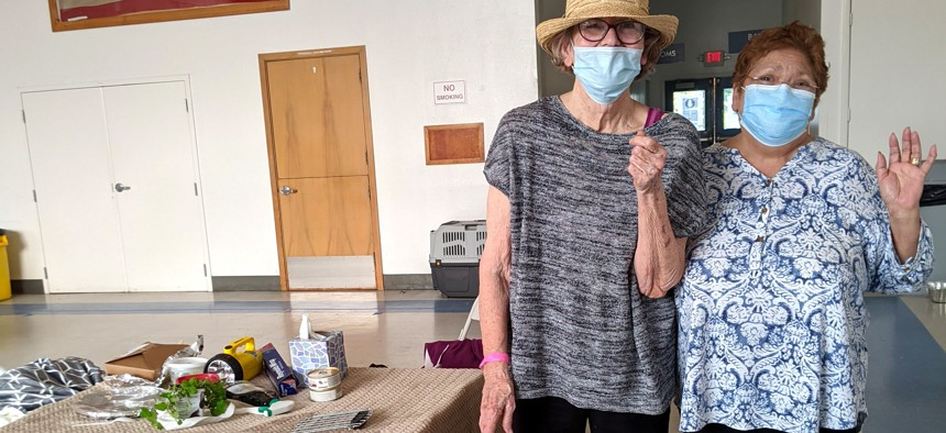 Santa Rosa residents Diana Dimas (left) and Magdalena Mulay stayed at the Petaluma Veterans Memorial Building and several other evacuation shelters at the end of last month after they had to flee a fast-moving wildfire for the second time in three years.