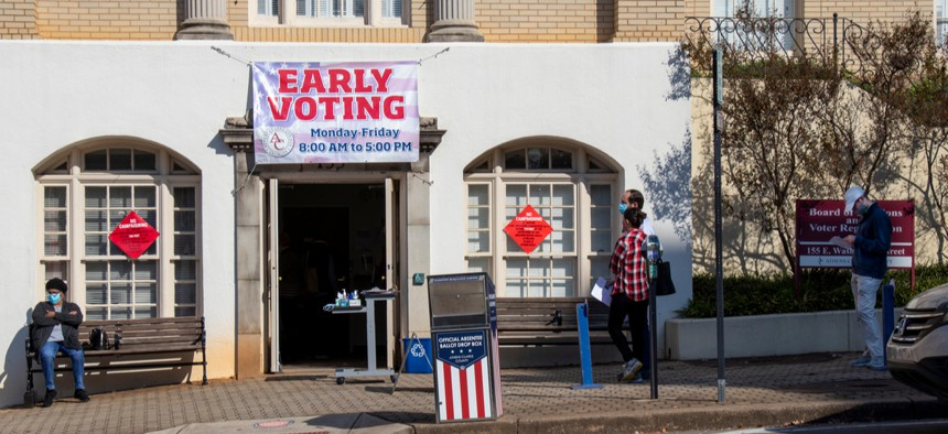 Voters wait outside a polling place in Athens, Georgia.