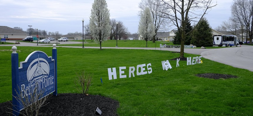 A sign is displayed at the Bethany Pointe Health Campus, Saturday, April 11, 2020, in Anderson, Ind. Multiple residents at the Indiana nursing home have died from Covid-19.