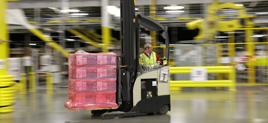A forklift operator moves a pallet of goods at a Amazon.com fulfillment center in DuPont, Wash.