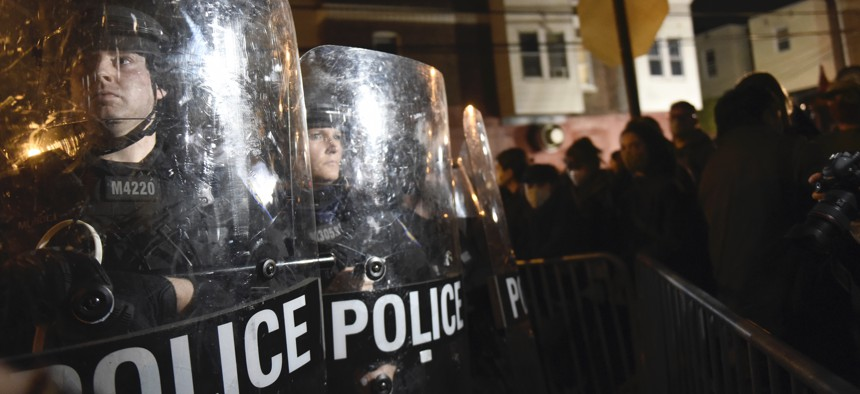 Philadelphia police officers form a line during a demonstration in Philadelphia, late Tuesday, Oct. 27, 2020.