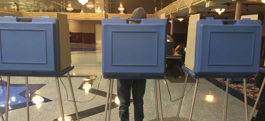 Voters fill out their ballots in Helena, Mont, on Election Day in 2018. This year, the state has a close race for governor.