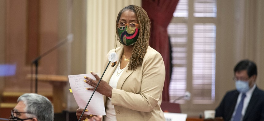 State Sen. Holly Mitchell, D-Los Angeles, talks to fellow members in Sacramento, Calif., on Aug. 31, 2020.