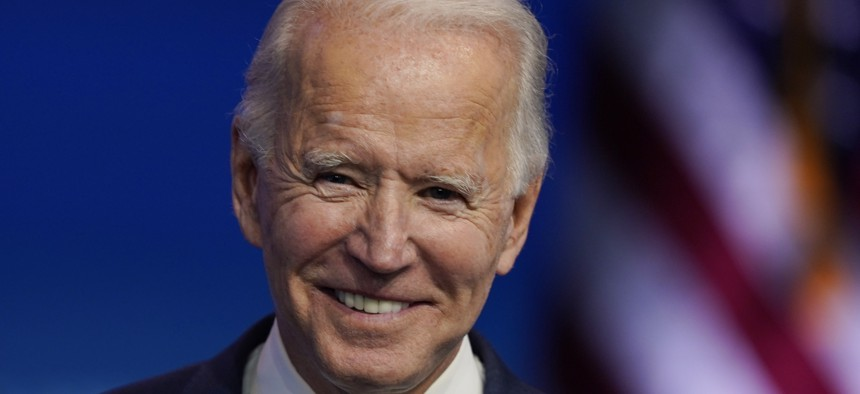 President-elect Joe Biden pauses as he listens to media questions at The Queen theater, Tuesday, Nov. 10, 2020, in Wilmington, Del.