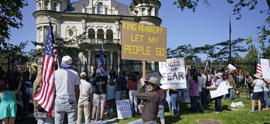 In this Sept. 12, 2020, file photo, people protest Gov. Gary Herbert during an anti-mask rally outside of the Governors Mansion in Salt Lake City. Protests have since spread to Herbert's private home in Orem, Utah.