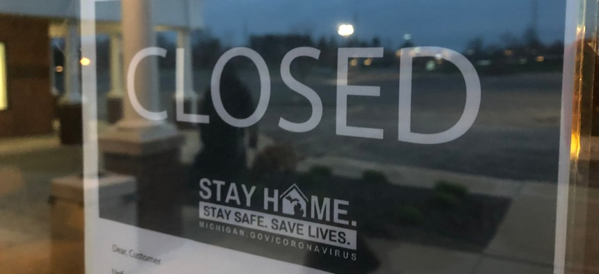 A closed store in Dexter, MI. The Michigan state Supreme Court ruled last month that the governor can't extend an emergency declaration without the legislature's consent and struck down one of two laws giving Gov. Gretchen Whitmer emergency authority.