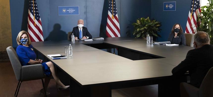 President-elect Joe Biden, speaks during a meeting with Vice President-elect Kamala Harris, right, Senate Minority Leader Chuck Schumer of N.Y., and House Speaker Nancy Pelosi of Calif., left, Friday, Nov. 20, 2020, in Wilmington, Del.