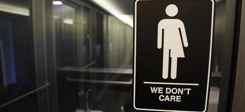 In 2016, a gender free sign hung outside a restroom at 21c Museum Hotel in Durham, N.C. A 3 1/2-year ban on local ordinances aimed at protecting LGBTQ rights in North Carolina expired on Dec. 1, 2020.