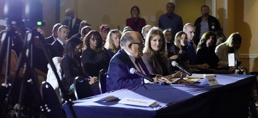 Rudy Giuliani, center, speaks at a hearing of the Pennsylvania State Senate Majority Policy Committee, Wednesday, Nov. 25, 2020, in Gettysburg, Pa.