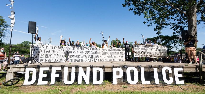 Activists call for defunding the police at a protest in Minneapolis in June.