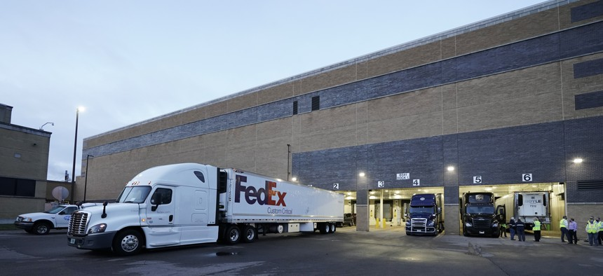 A truck loaded with the Pfizer-BioNTech COVID-19 vaccine leaves the Pfizer Global Supply Kalamazoo manufacturing plant in Portage, Mich., Sunday, Dec. 13, 2020.