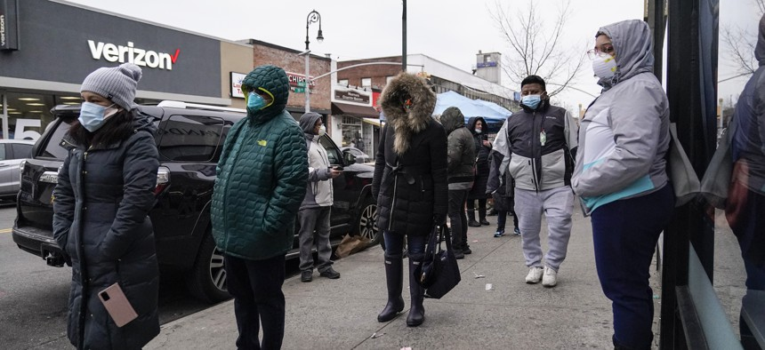 People wait on a line for a CityMD Urgent Care location on Dec. 16, 2020, in the Forest Hills neighborhood of the Queens borough of New York.