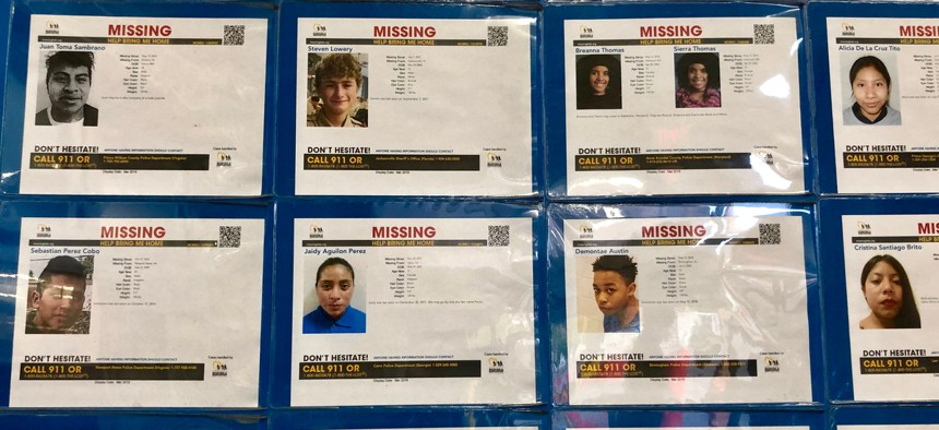 A wall of missing people at a grocery store in Jacksonville, Florida.