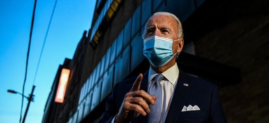 President-elect Joe Biden speaks with reporters in Wilmington, Delaware, on Nov. 24.