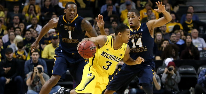 The University of Michigan basketball team faces off against West Virginia University.