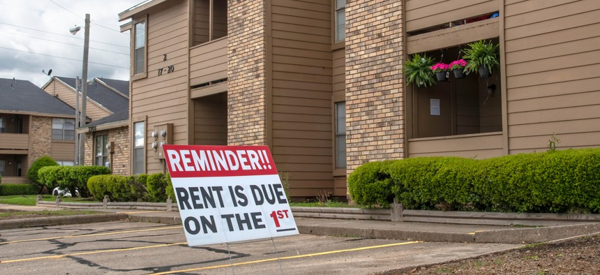 """A sign in the parking lot of an apartment complex in Bossier City, Louisiana on March 30, 2020 reminds tenants that """"Rent is due on the 1st."""""""