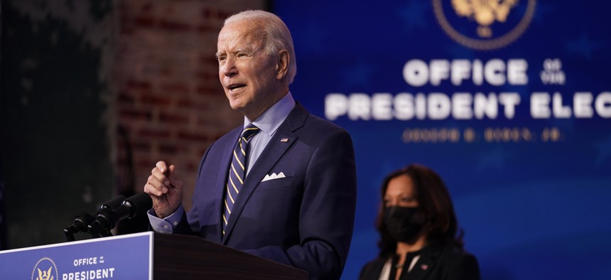 President-elect Joe Biden speaks at The Queen theater, Monday, Dec. 28, 2020, in Wilmington, Del. Vice President-elect Kamala Harris listens at right.