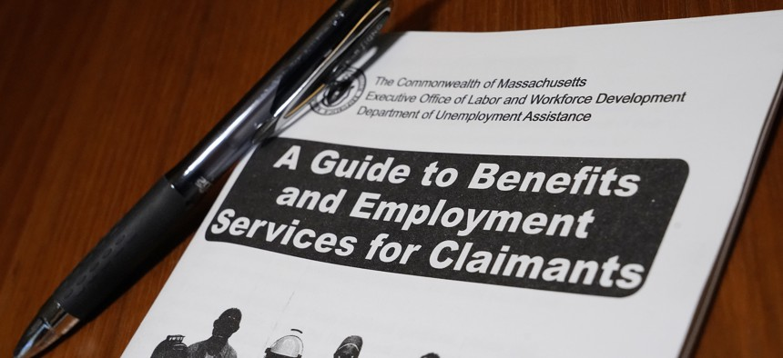 A booklet describing unemployment benefits is seen on a desk, Thursday, Nov. 5, 2020, in North Andover, Mass.
