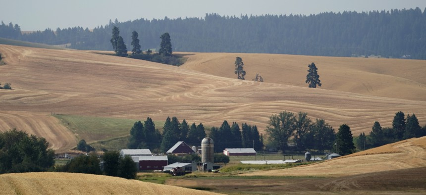 Freshly cut wheat fields are shown near a farm, Tuesday, Aug. 18, 2020, near Moscow, Idaho. Harvest is in full swing in the region known as the Palouse.